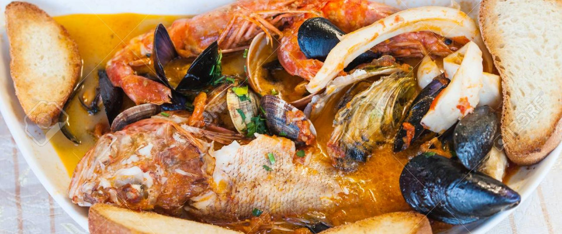 Special fish dinner at typical restaurant in the historical center of Sirolo